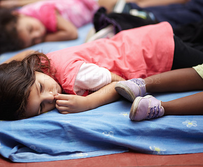 Buy stock photo Preschool children all lying down and getting ready to nap