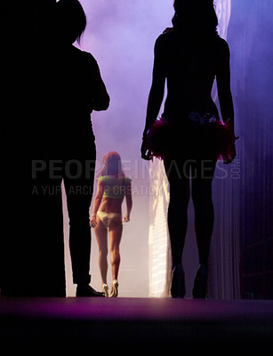 Buy stock photo Silhouette of a pageant contestant waiting in the wings to move on stage