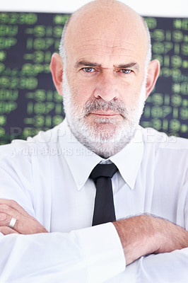 Buy stock photo Portrait of a serious stock broker standing with his arms folded