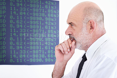 Buy stock photo Shot of a mature stock broker looking pensive in the office