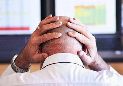Buy stock photo Rear view shot of a businessman looking stressful while placing his hands behind his head