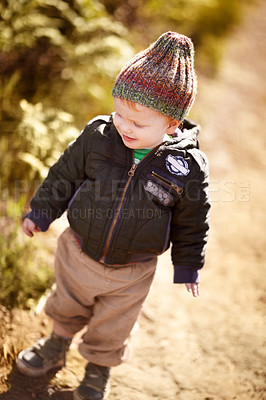 Buy stock photo A high angle view of a little boy standing outside