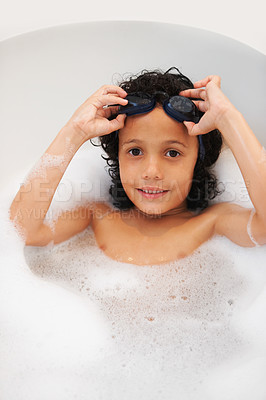 Buy stock photo Portrait of a cute young boy taking a bath with goggles on his head