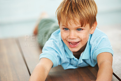 Buy stock photo A cute young boy playing on the dinner table at home