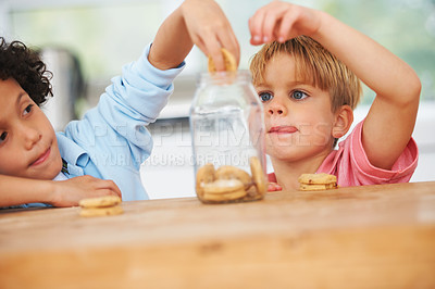 Buy stock photo A little boy grabbing some cookies
