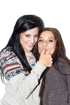 Buy stock photo Portrait of a brunette sucking her friends thumb on a white background