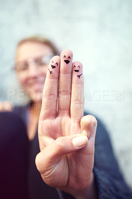 Buy stock photo Cropped shot of fingers with smileys drawn on them