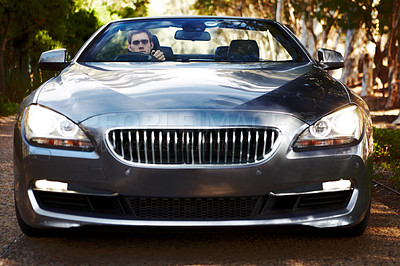 Buy stock photo Portrait of a man sitting his silver sportscar which is facing you