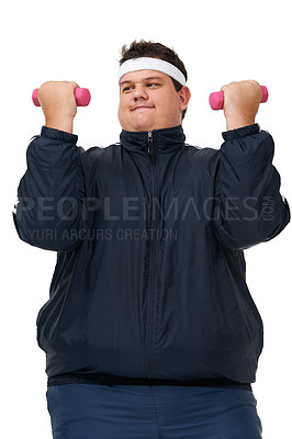 Buy stock photo A studio shot of an obese man lifting weights and exerting himself