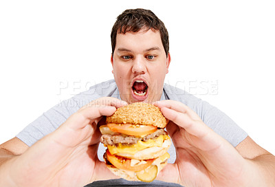 Buy stock photo An obese young man about to eat a huge hamburger