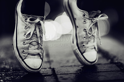 Buy stock photo Cropped image of a person wearing sneakers standing on their toes in the street