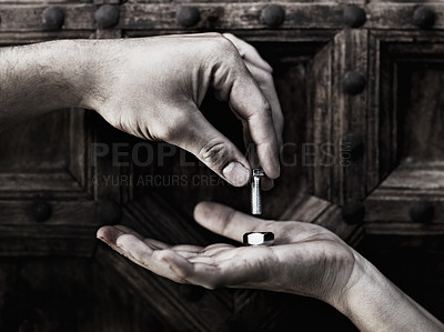 Buy stock photo Closeup of two hands screwing a nut and bolt together