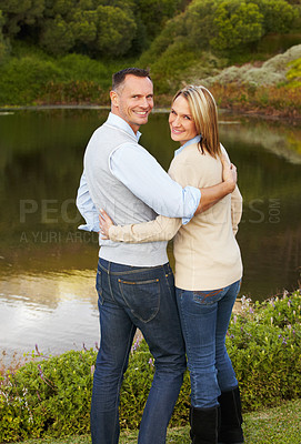 Buy stock photo Portrait of a loving mature couple standing near a lake