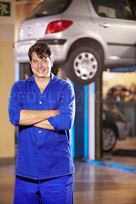 Buy stock photo Portrait of a male mechanic standing confidently in the workshop