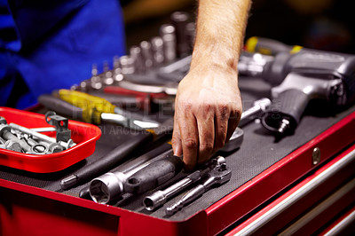 Buy stock photo Cropped image of a man's hands grabbing a tool from his toolbox