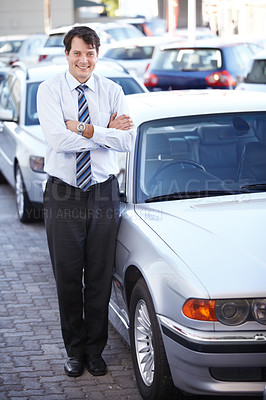 Buy stock photo A man standing confidently in his parking lot