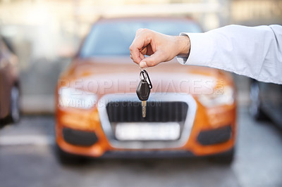 Buy stock photo Cropped image of a man's hands handing over a car key