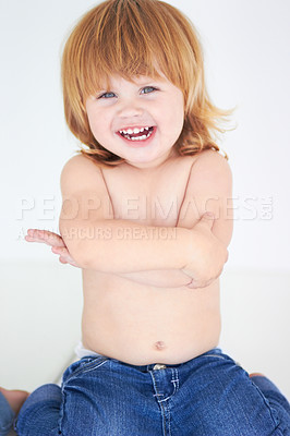 Buy stock photo A cute baby smiling happily with her arms folded