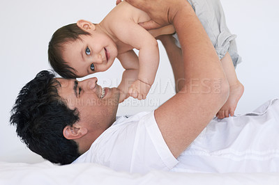 Buy stock photo Shot of an affectionate young father and his baby boy