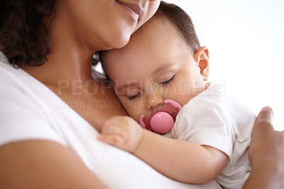 Buy stock photo Closeup of a baby girl sleeping in her mother's arms
