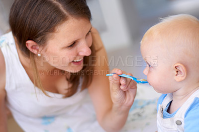 Buy stock photo Young beautiful mother holding her cute baby