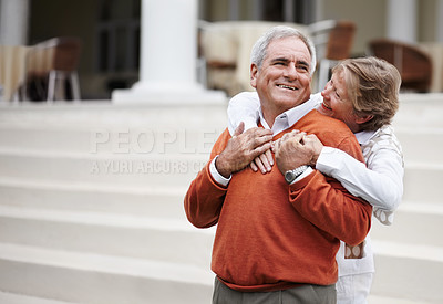 Buy stock photo A loving senior couple hugging each other while on a relaxing vacation