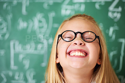 Buy stock photo A cute blonde girl laughing in class