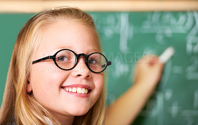 Buy stock photo Portrait of a cute blonde girl using chalk in class
