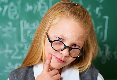 Buy stock photo Portrait of a cute blonde girl looking thoughtful in class