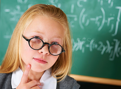 Buy stock photo Portrait of a cute blonde girl thinking in class