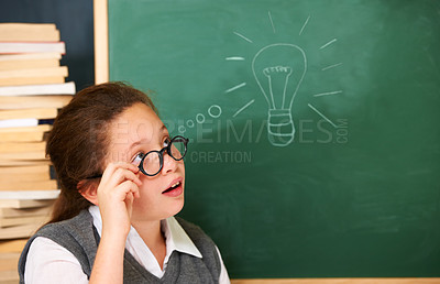 Buy stock photo A cute brunette girl coming up with an idea in class