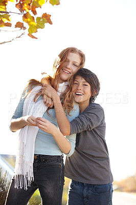 Buy stock photo Portrait of a young boy with his arms around his sister