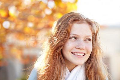 Buy stock photo A pretty young girl standing outside under the autumn trees