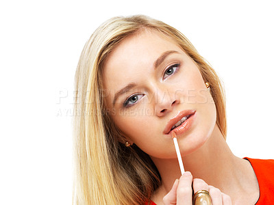 Buy stock photo Portrait of a gorgeous blonde woman applying lipgloss