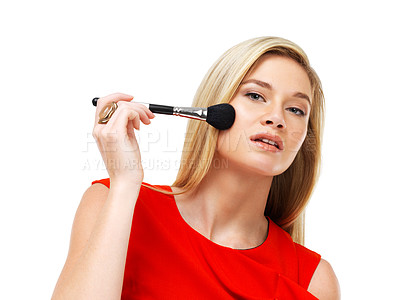 Buy stock photo Portrait of a young blonde woman applying blusher against a white background