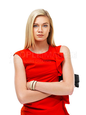 Buy stock photo A stunning young blonde woman standing with arms folded while holding a clutch bag