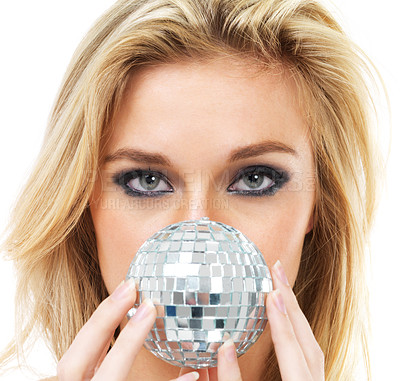 Buy stock photo Portrait of a gorgeous young blonde woman holding a disco ball in front of her face