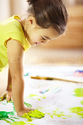 Buy stock photo shot of a mischievous child making a mess while painting