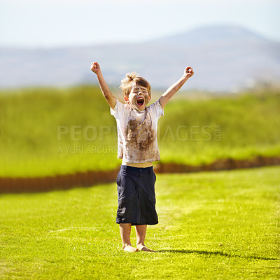 Buy stock photo Cute little boy cheering while standing outdoors