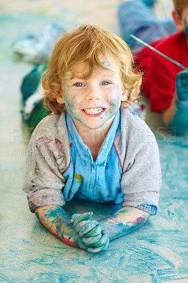 Buy stock photo A little boy covered in paint