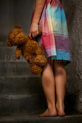 Buy stock photo Cropped view of a little girl holding a teddy bear