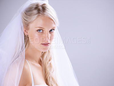 Buy stock photo Portrait of a beautiful young bride standing against a lilac background