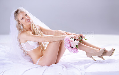 Buy stock photo Full length portrait of a stunning young bride on her bed in her lingerie