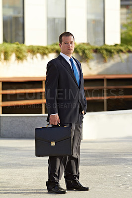 Buy stock photo Portrait of a businessman holding a briefcase