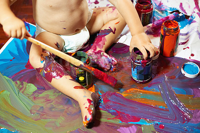 Buy stock photo Little baby boy painting on the floor with vibrant colors