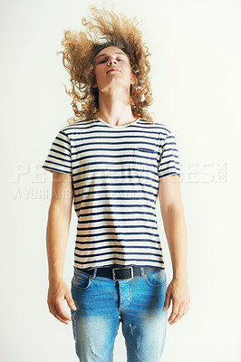 Buy stock photo Young man with curly long hair head-banging