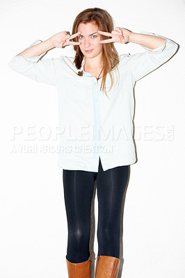 Buy stock photo Gorgeous young woman making V-signs around her eyes