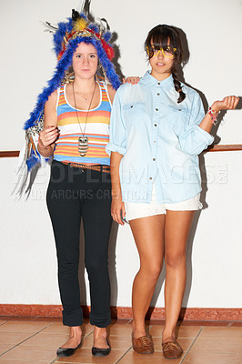 Buy stock photo Two young trendy friends standing together indoors wearing hipster garb