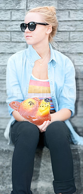 Buy stock photo Young hipster girl sitting and looking away while holding an animal mask