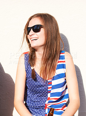 Buy stock photo Happy young hipster laughing while sitting outdoors
